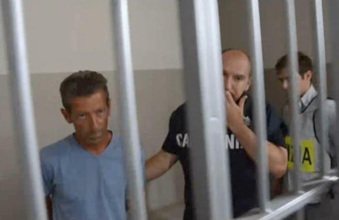 In un fermo immagine tratto da un video della polizia il 19 giugno 2014 Massimo Giuseppe Bossetti trasferito in carcere