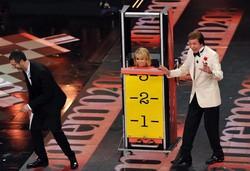 Fabio Fazio, Luciana Littizzetto e il mago Silvan durante la quarta serata del Festival di Sanremo, sul palco del Teatro Ariston