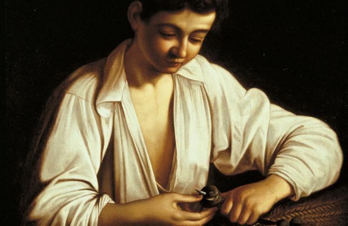 Il ragazzo che pela la frutta di Michelangelo Merisi