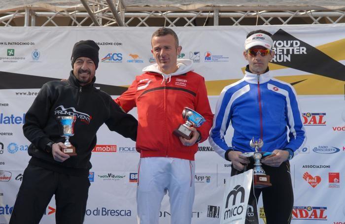 Il podio della Maratona di Brescia 2015. Da sinistra Paolo Lanfranchi, Marco Ferrari, Luca Nascimbeni
