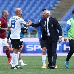 Reja si congratula con Migliaccio  a fine partita