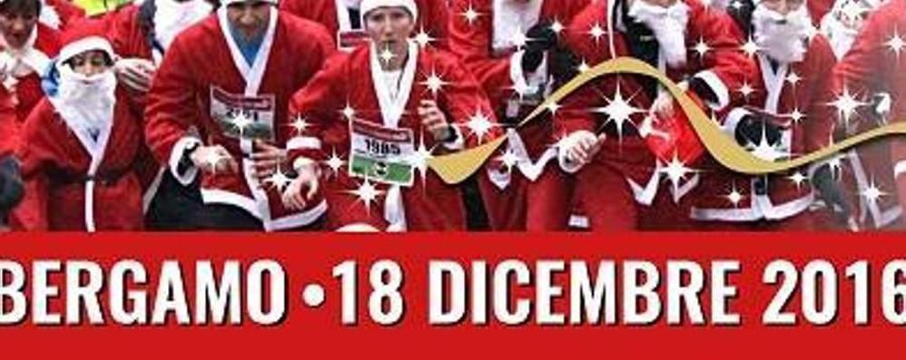 Domenica la «Babbo Running» Si corre in rosso per aiutare i bambini