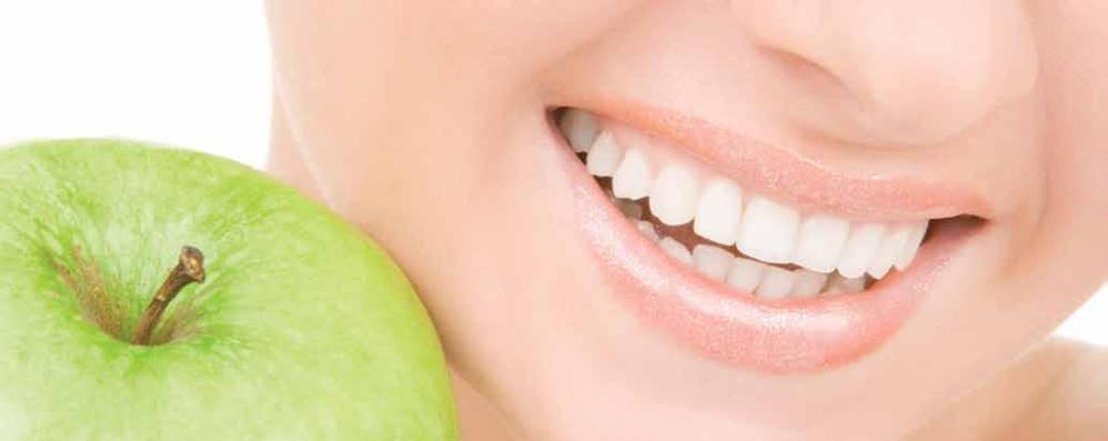 Denti, nuova scoperta L'inquinamento favorisce la carie