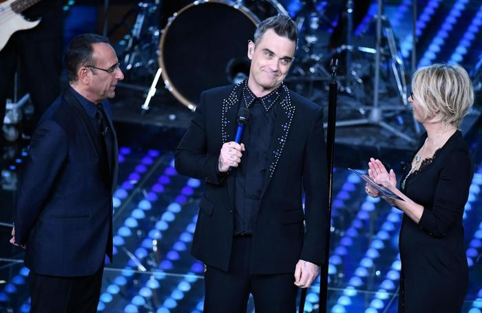 Italian host Carlo Conti, British singer Robbie Williams, Italian host Maria De Filippi on stage during the 67th Festival of the Italian Song of Sanremo at the Ariston theater in Sanremo, Italy, 08 February 2017. The 67th edition of the television song contest runs from 07 to 11 February. ANSA/ETTORE FERRARI