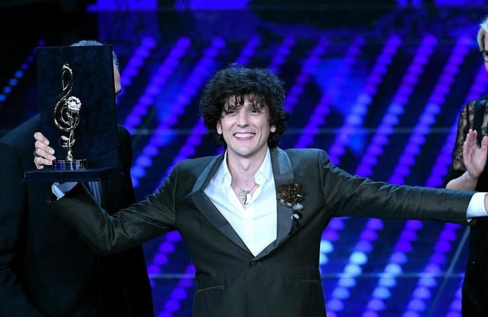 Italian singer Ermal Meta celebrates on stage after winning a trophy for the Best Cover during the 67th Festival of the Italian Song of Sanremo at the Ariston theater in Sanremo, Italy, 09 February 2017. The 67th edition of the television song contest runs from 07 to 11 February. ANSA/CLAUDIO ONORATI