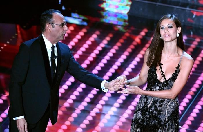 Italian host Carlo Conti and Italian model Marica Pellegrinelli on stage during the 67th Festival of the Italian Song of Sanremo at the Ariston theater in Sanremo, Italy, 10 February 2017. The 67th edition of the television song contest runs from 07 to 11 February. ANSA/ETTORE FERRARI