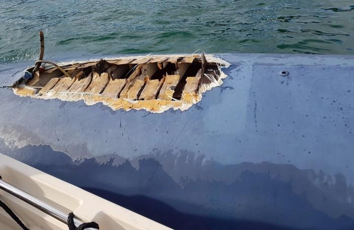 La barca danneggiata