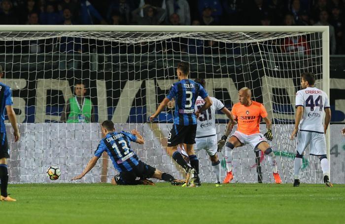 Atalanta's defender Mattia Caldara (L) scores a goal (2-0)