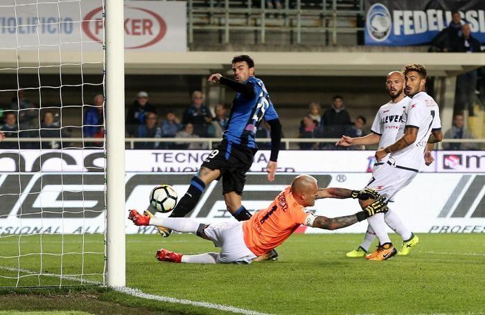 Atalanta's forward Andrea Petagna (L) scores a goal (1-0)