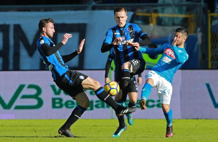 Atalanta's players, Bryan Cristante (L) and Josip Ilicic (C), and Napoli's forward Lorenzo Insigne (R)