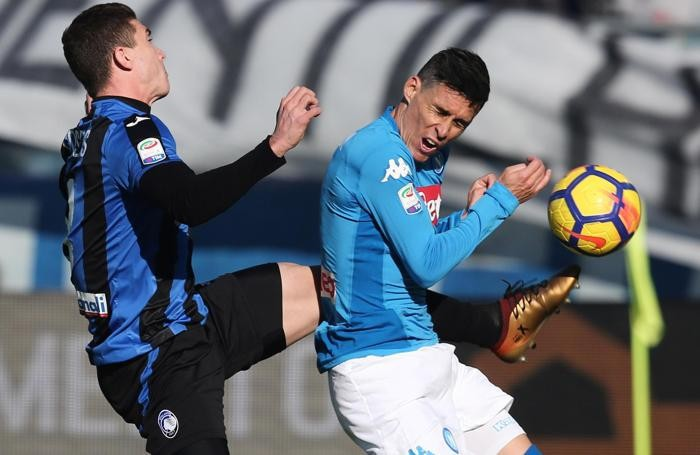 Atalanta's Robin Gosens (L) and Napoli's forward Jose Callejon