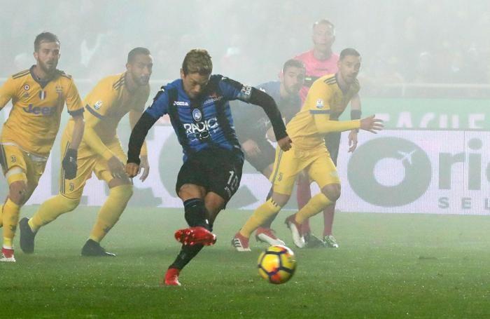 Atalanta's Alejandro Dario Gomez misses a penalty kick