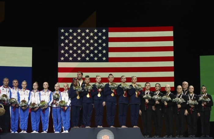 Team U.S.A., center and gold medal, team Russia, left and silver medal, and team Italy, right and bronze medal,