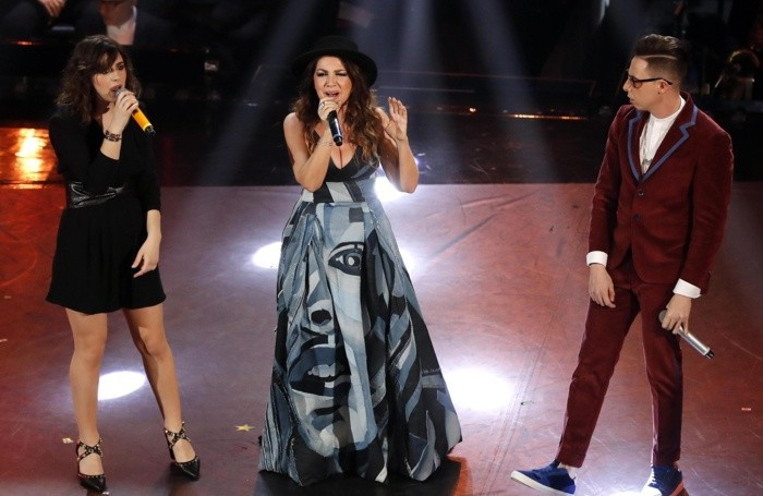 Italian singers Federica Carta (L) and Shade (R) with Cristina D'Avena (C) perform