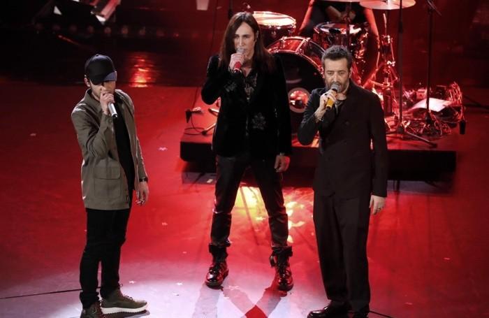 Italian singers Daniele Silvestri (R), Rancore (L) and Manuel Agnelli (C)