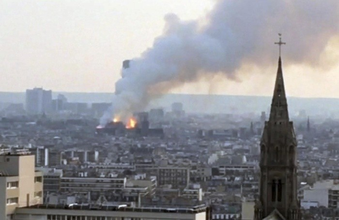 Plumes of smoke rises from Notre Dame