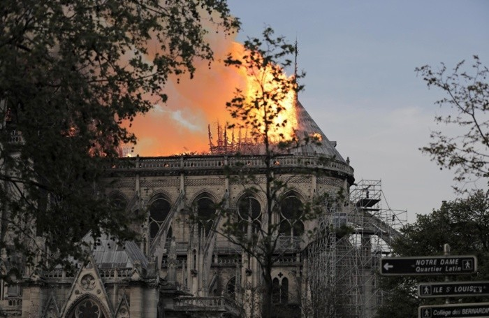 epa07508838 Flames on the roof of the Notre-Dame Cathedral in Paris, France,