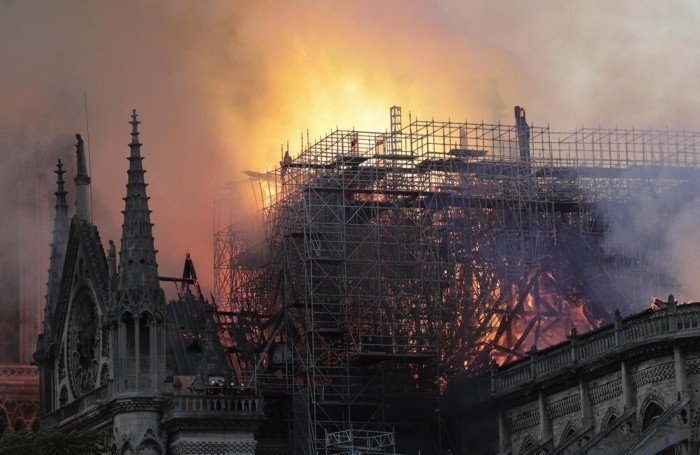epa07509074 Flames on the roof of the Notre-Dame Cathedral in Paris, France,