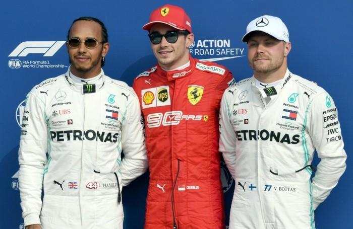 Monaco's Formula One driver Charles Leclerc (C) of Scuderia Ferrari