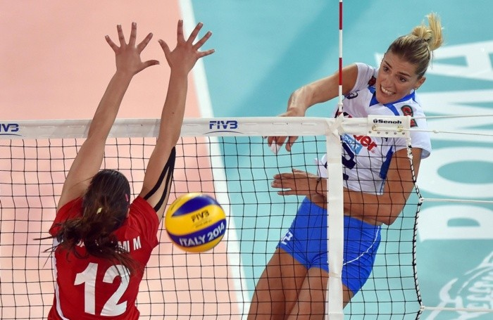 Italy's Francesca Piccinini (R) spikes the ball against Tunisia's Marwa Barhoumi (L) during the group A match between Italy and Tunisia of the Women's Volleyball World Championship in Rome, Italy, 23 September 2014. ANSA/ETTORE FERRARI