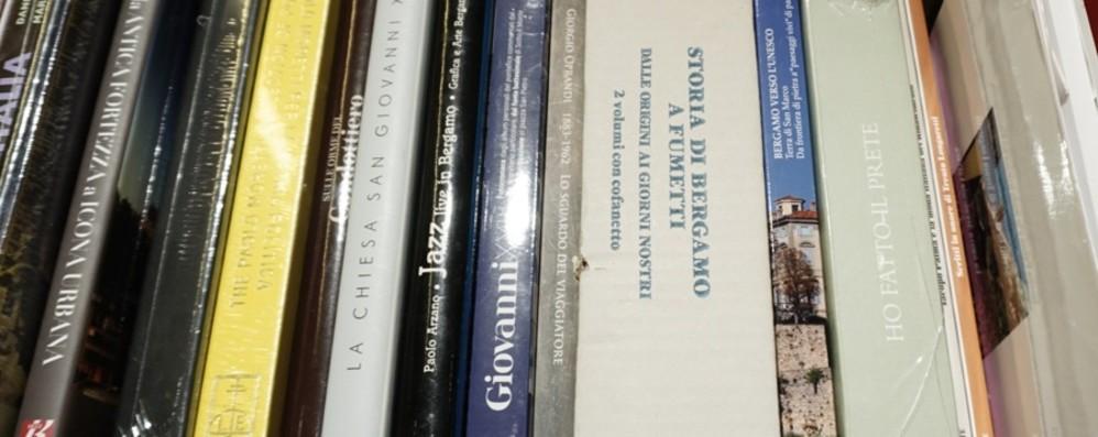 Al via in città «PortAMI un libro» Li consegna BergamoxBergamo