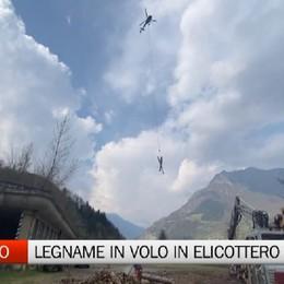 Ardesio, legname in volo in elicottero
